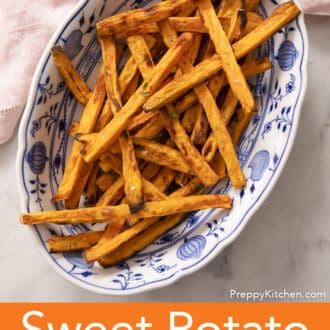 sweet potato fries on a blue and white platter