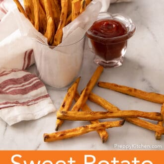sweet potato fries in a cup with a side of ketchup