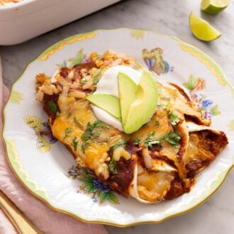 Two chicken enchiladas on a plate