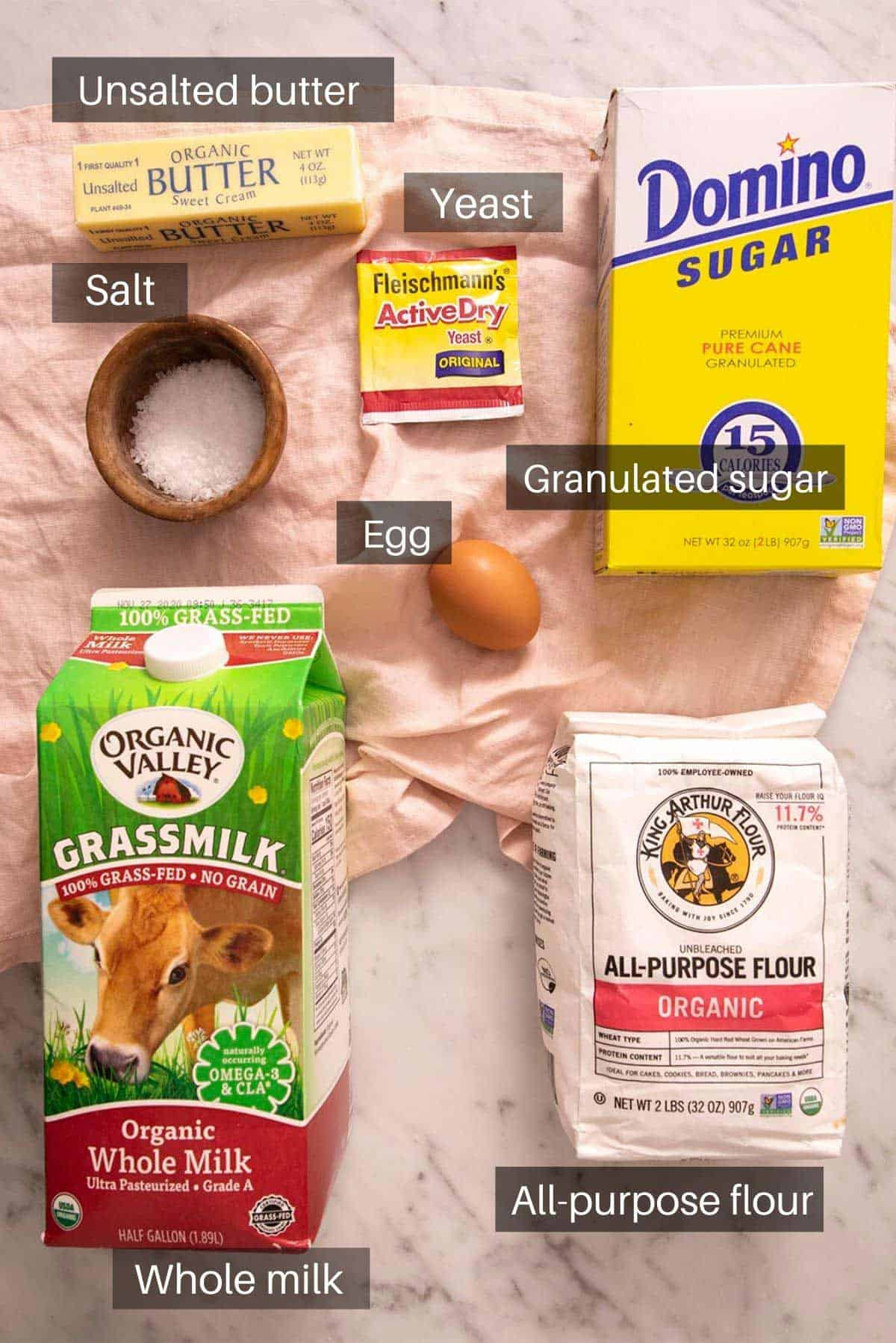 An overhead shot of all the ingredients you need to make dinner rolls