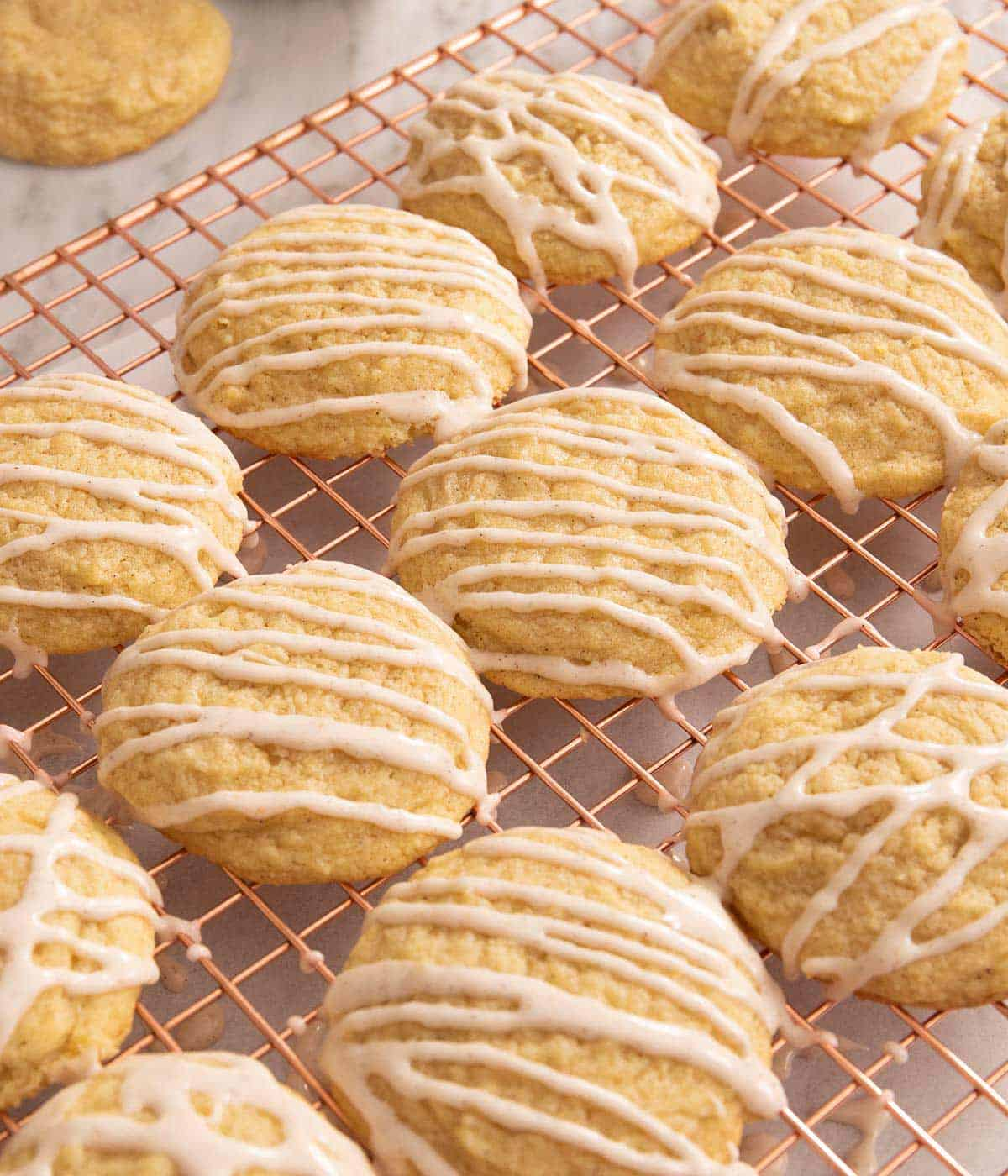 A close up of eggnog cookies on a cooling rack