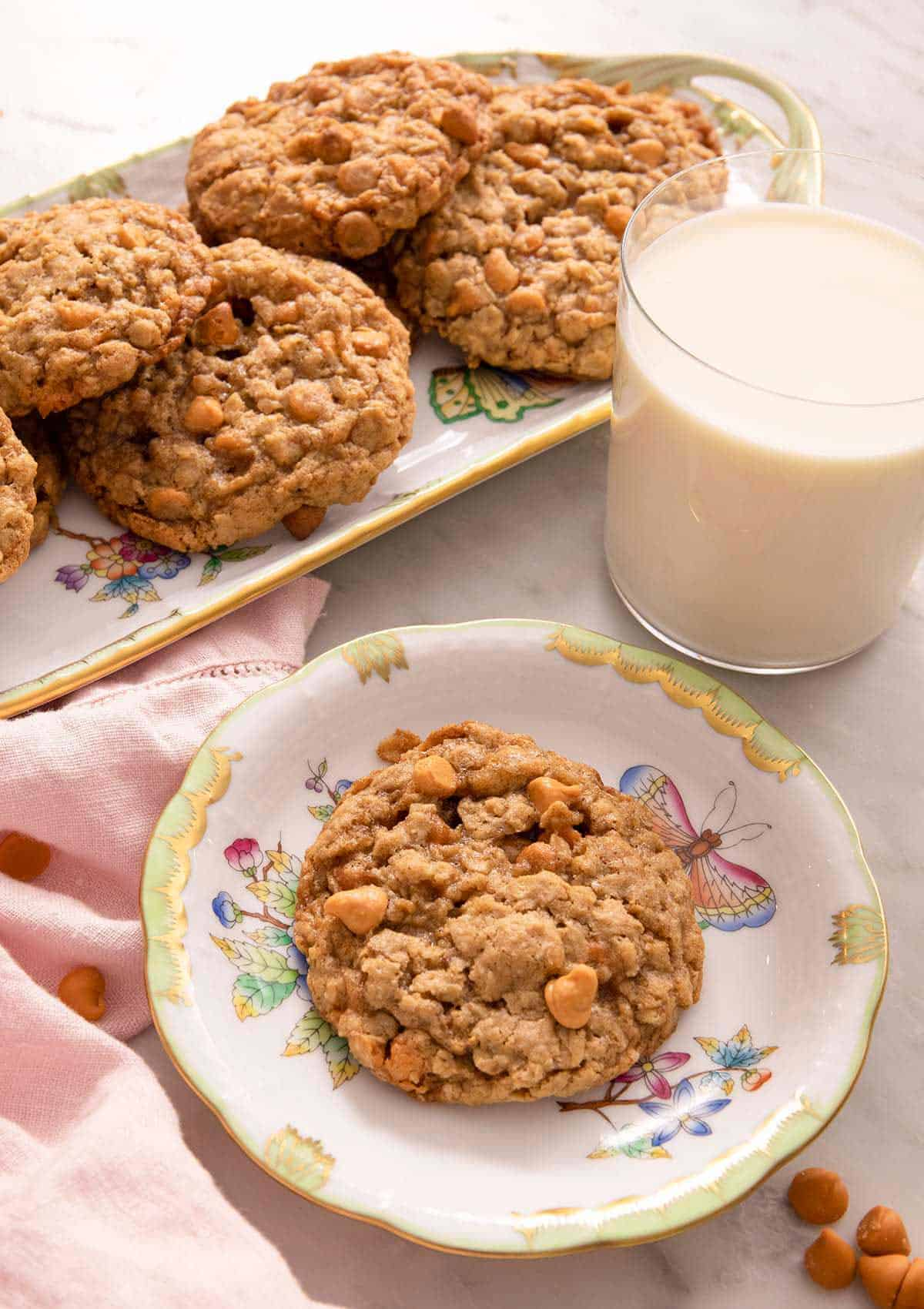Oatmeal scotchies on plates with a glass of milk