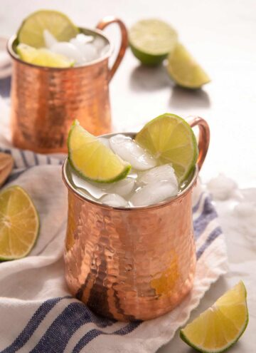 A side shot of a Moscow Mule cocktail in a copper mug