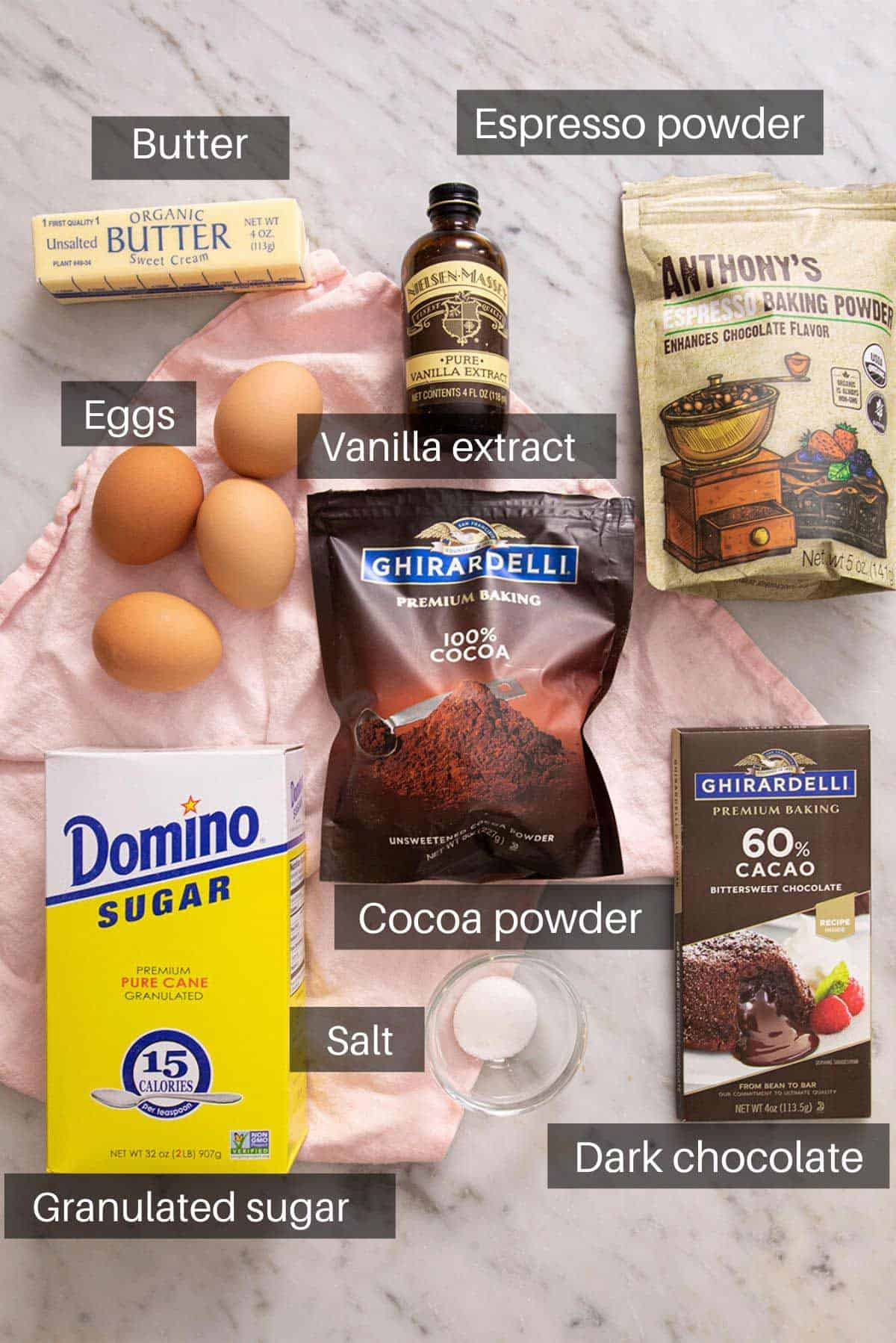 An overhead shot of all the ingredients you need to make flourless chocolate cake