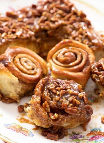 A close up of sticky buns with pecans