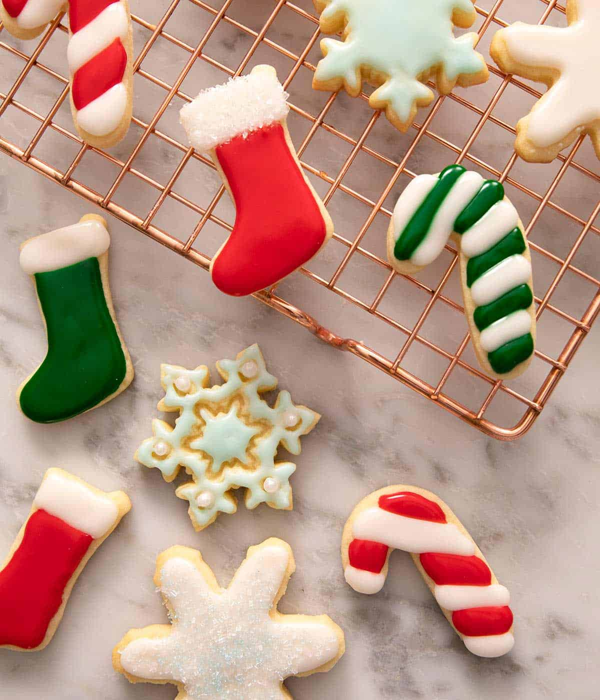 An overhead shot of different festive cookies with colored sugar cookie icing