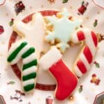 A close up of Christmas sugar cookies on a plate