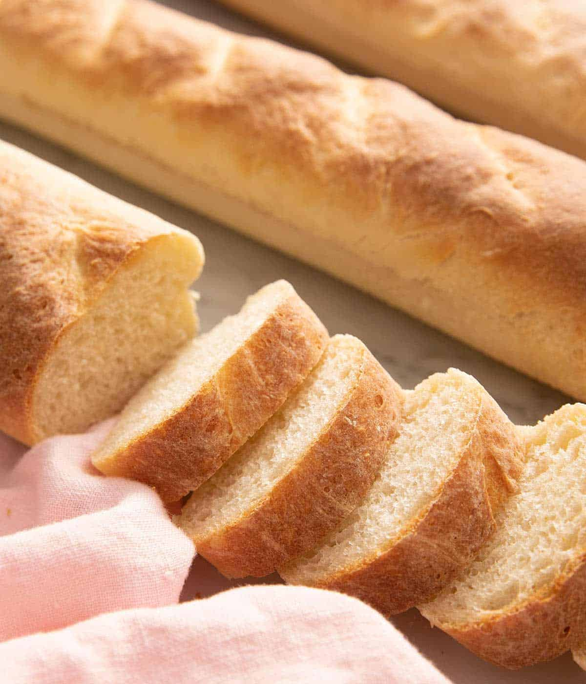 A close up of French bread cut into slices