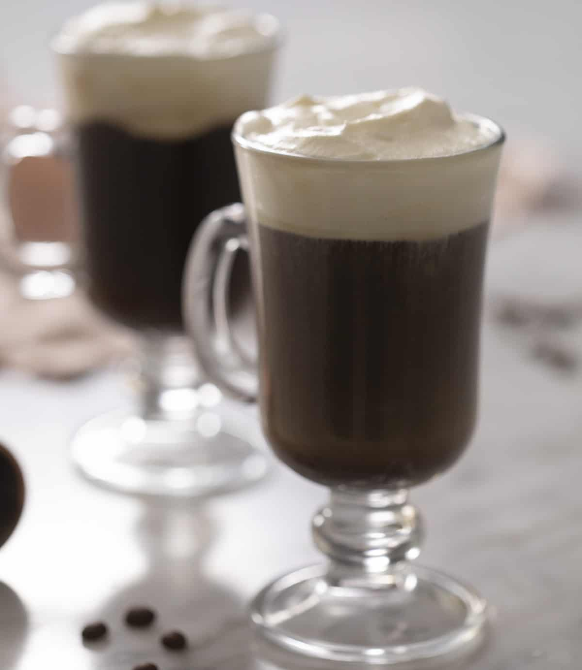 A close up of an Irish coffee in a glass mug