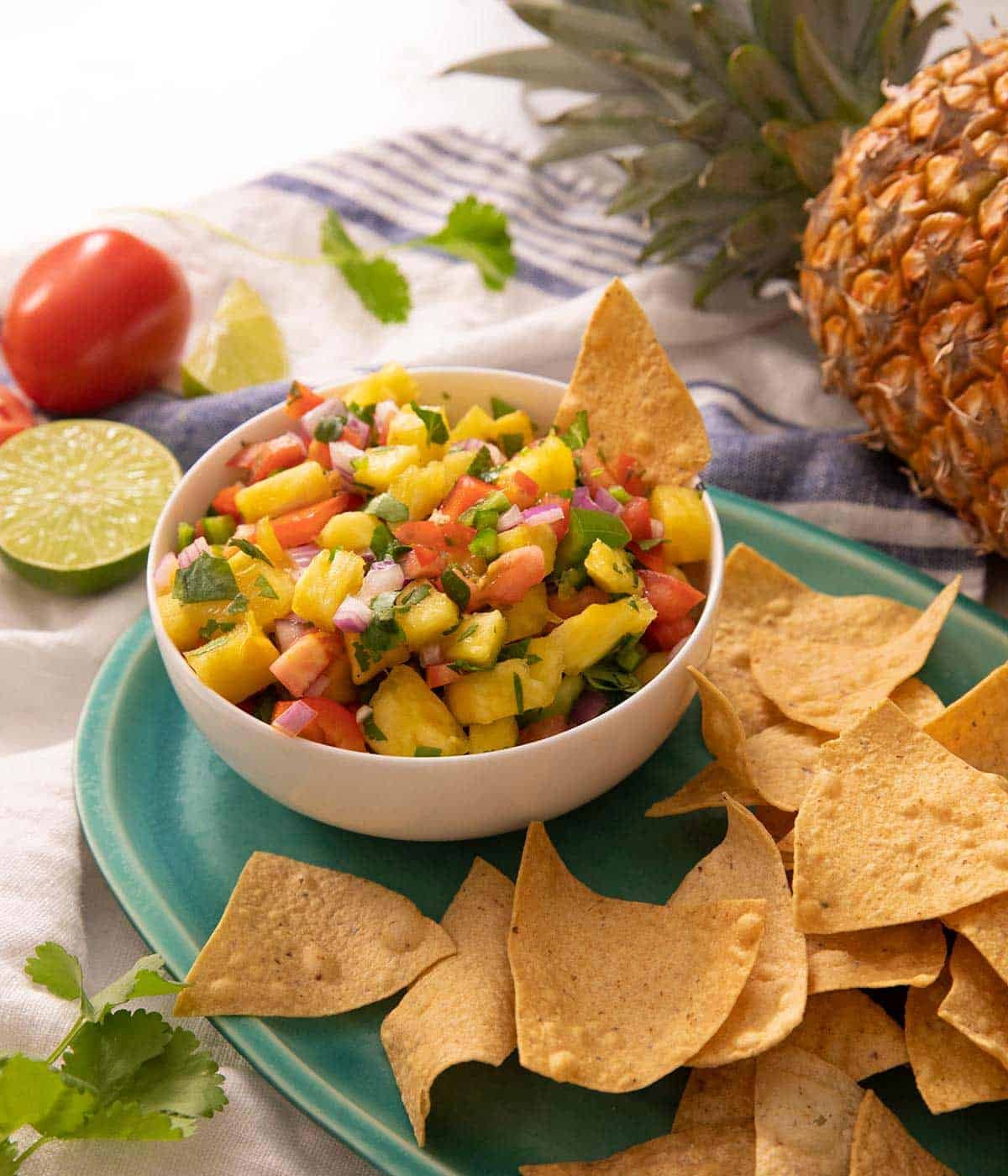 Pineapple salsa in a bowl with tortilla chips at the side