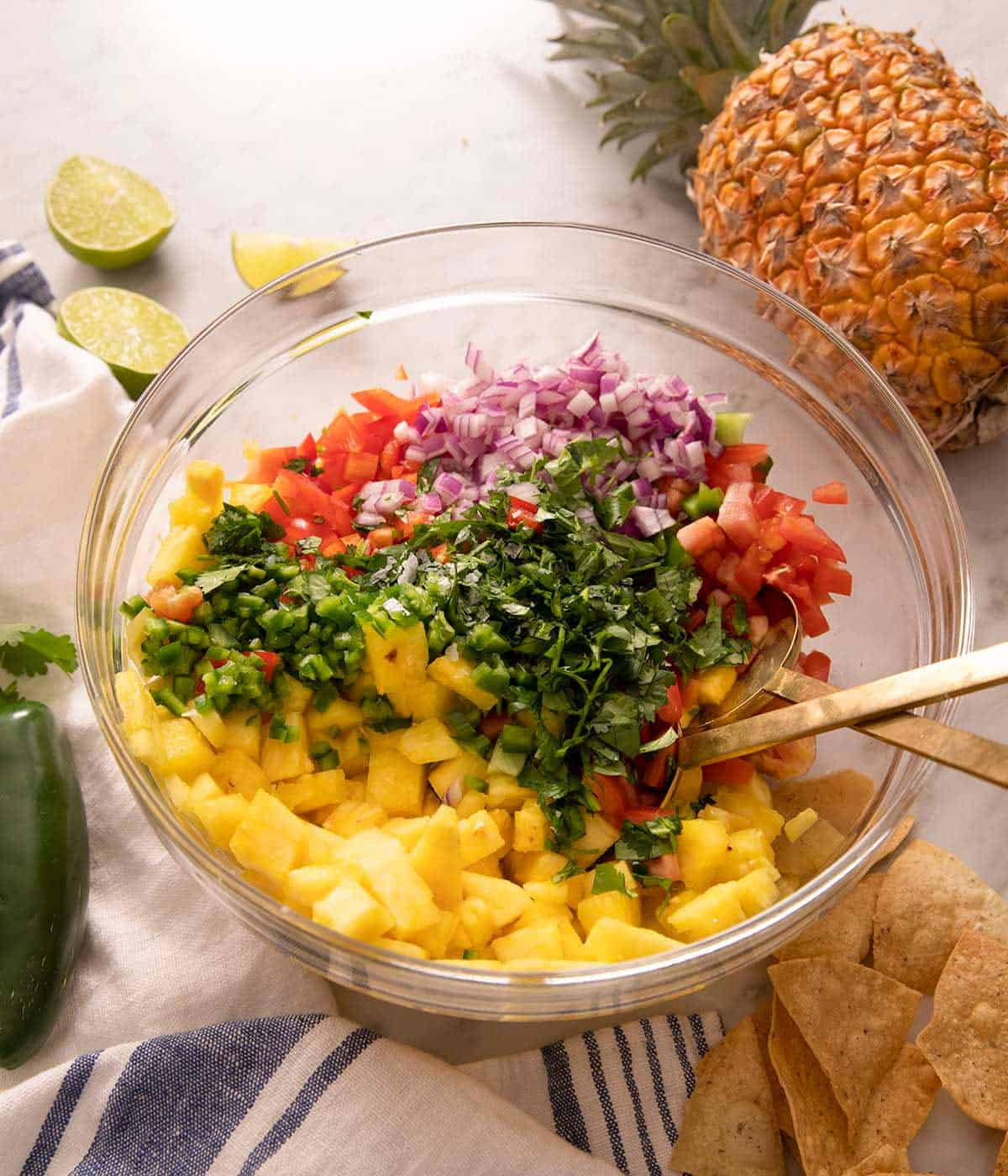 Pineapple salsa ingredients in a large mixing bowl