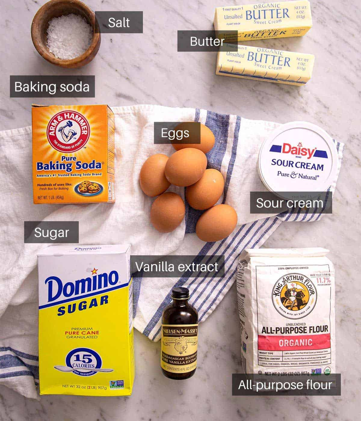 An overhead shot of all the ingredients you need to make a sour cream pound cake
