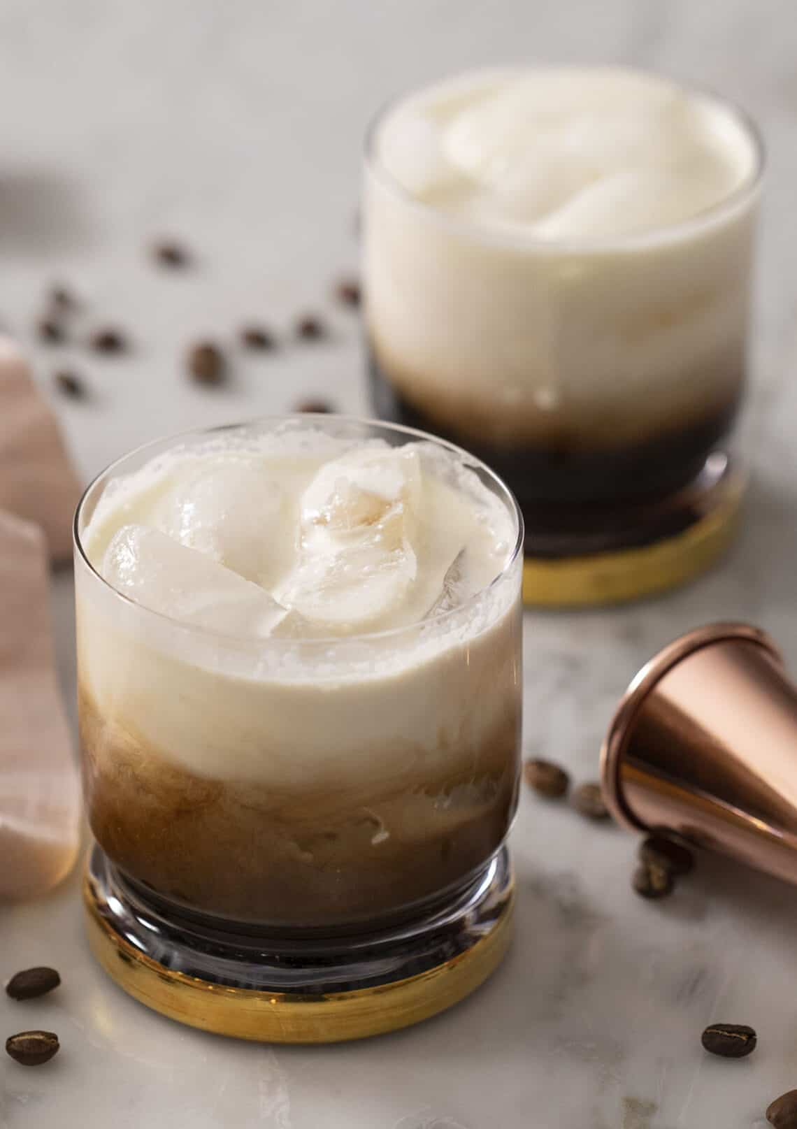 Two White Russian cocktails on a marble surface