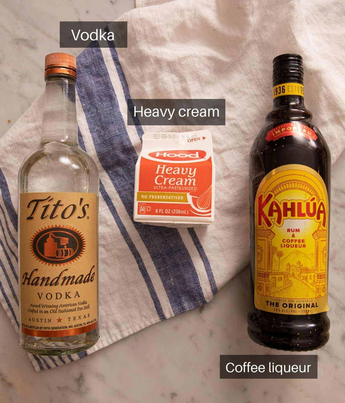 An overhead shot of all the ingredients you need to make a White Russian cocktail
