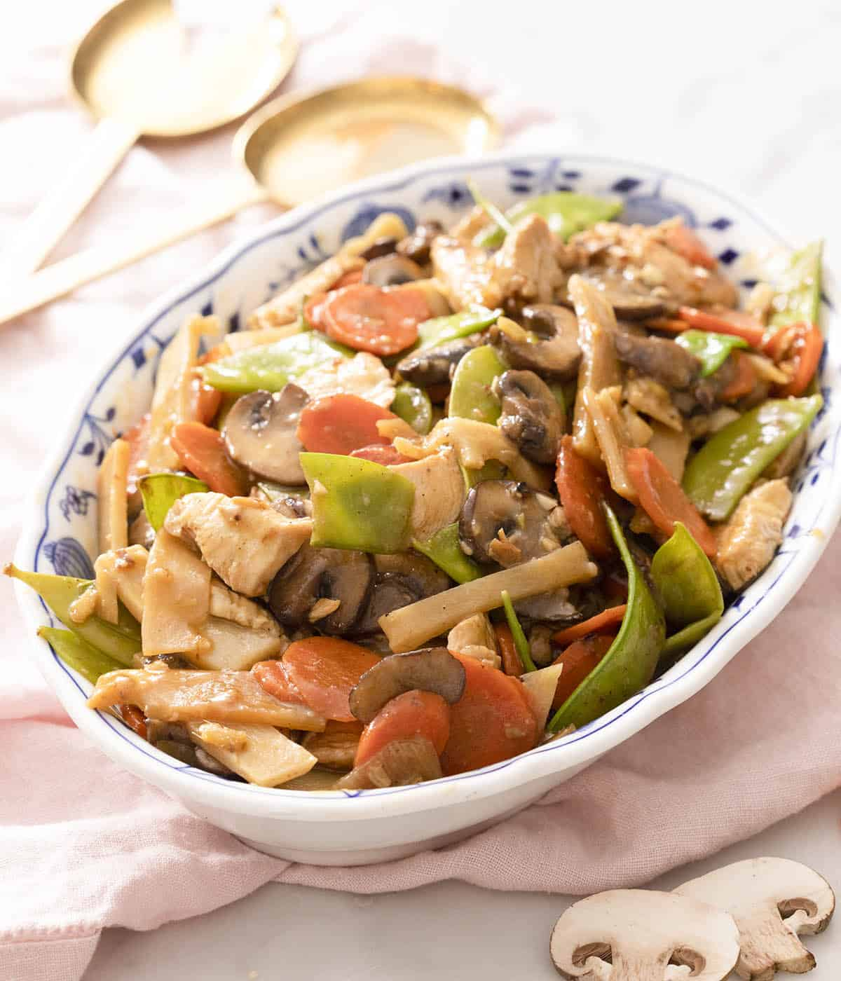 Moo goo gai pan stir fry in a large serving bowl