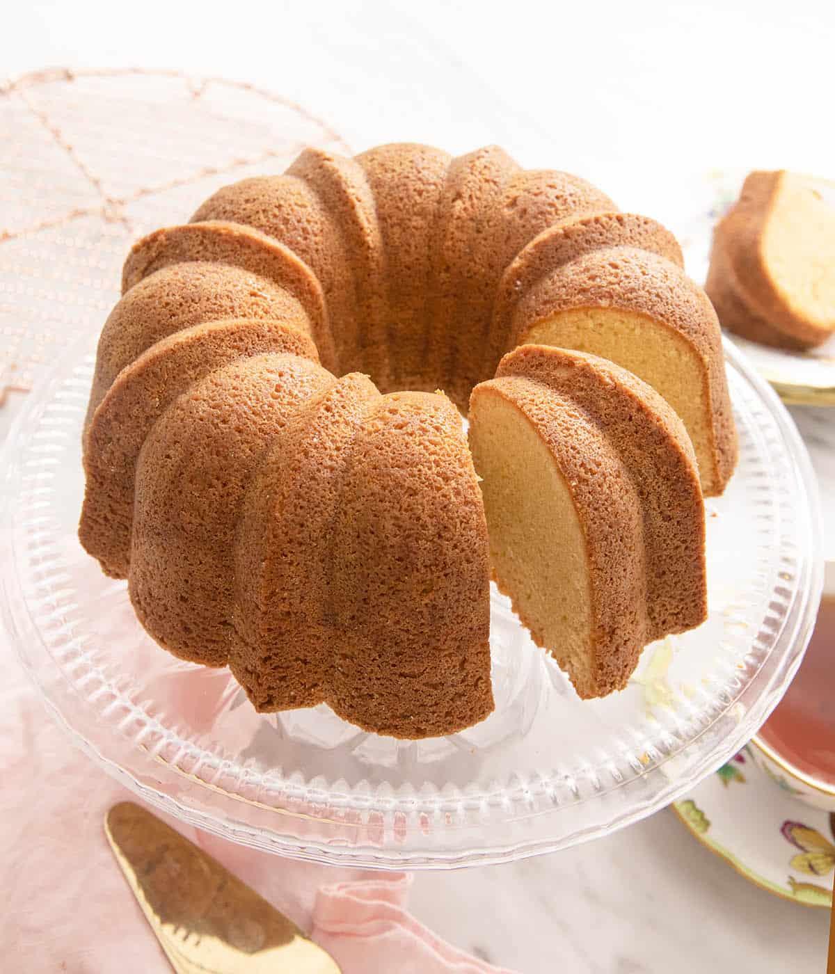 A sour cream pound cake on a cake stand