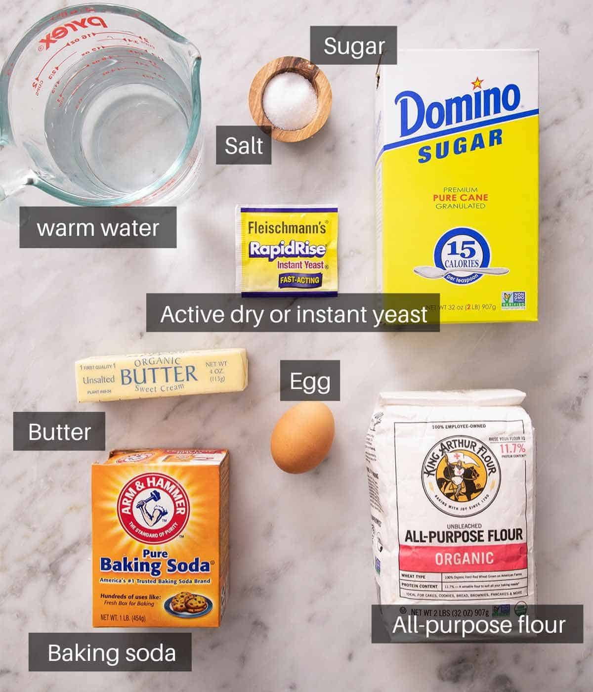 An overhead shot of all the ingredients you need to make soft pretzels