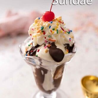 Pinterest graphic of a glass of vanilla ice cream topped with hot fudge, whipped cream, sprinkles, and a cherry.