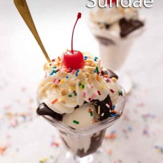 Pinterest graphic of two glasses of hot fudge sunday with whipped cream, sprinkles, and a cherry.