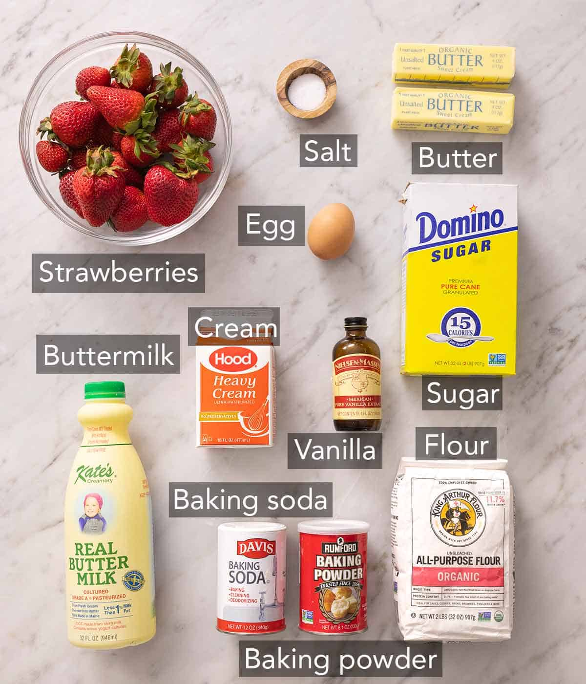 Ingredients needed to make strawberry shortcakes.
