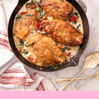 Pinterest graphic of a pan of Tuscan chicken with spinach and sundried tomatoes.