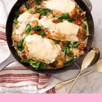 Pinterest graphic of a four chicken breasts covered in a creamy Tuscan chicken sauce.