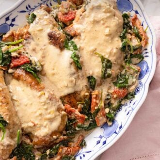 Pinterest graphic of a close up of a plate of Tuscan chicken by a pink linen.