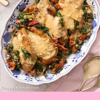 Pinterest graphic of a plate of four servings of Tuscan chicken with spinach, sun-dried tomatoes, and a creamy sauce.