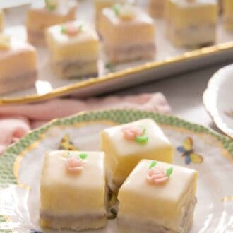 Pinterest graphic of three petit fours on a porcelain plate.