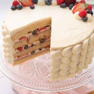 Pinterest graphic of a Chantilly cake with a slice removed.