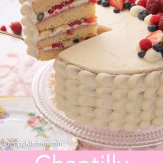 Pinterest graphic of a slice of Chantilly cake being lifted from the full cake on a cake stand.