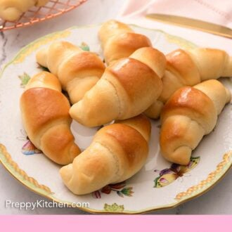 Pinterest graphic of crescent rolls on a plate on top of a pink linen napkin.
