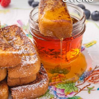 Pinterest graphic of a French toast stick with syrup dripping off laid over top of a small mason jar of maple syrup.