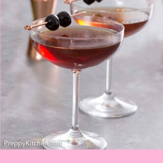 Pinterest graphic of two manhattan cocktails with two maraschino cherries on a pick on top of each drink.