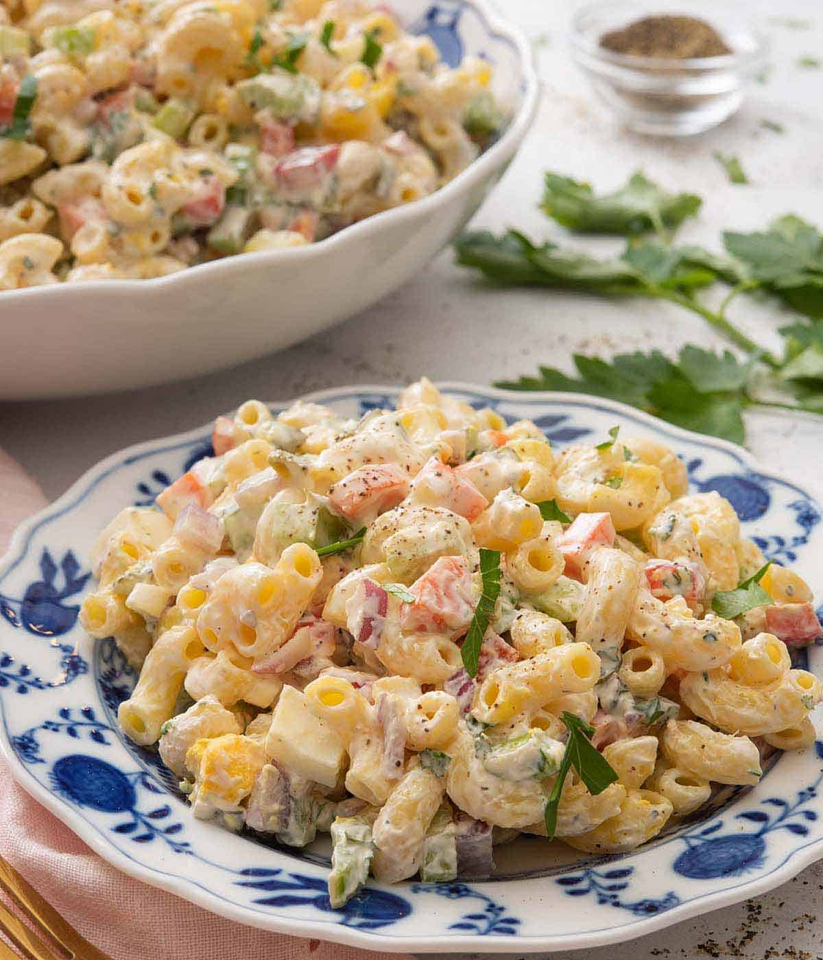 A blue and white plate of macaroni salad.