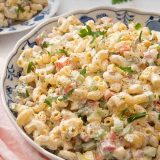 Pinterest graphic of a large serving bowl of macaroni salad.