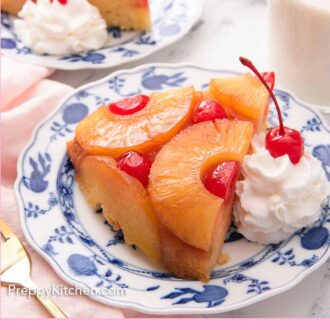 Pinterest graphic of two plates with a slice of pineapple upside down cake on each with a dollop of whipped cream on the side.