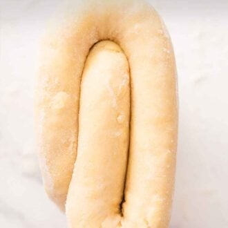 Pinterest graphic of a folded piece of puff pastry.