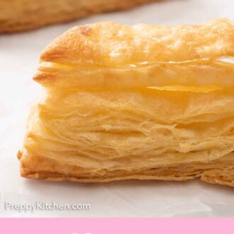 Pinterest graphic of a close up of puff pastry, showing its height and layers.