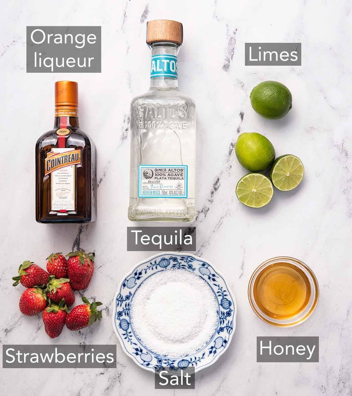 Ingredients needed to make strawberry margaritas.