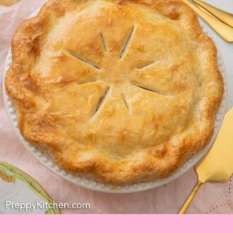 Pinterest graphic of the overhead view of a baked turkey pot pie with 7 cuts on the crust, in a white pie dish.