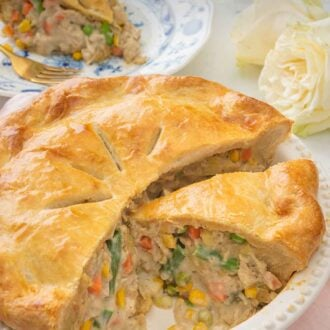 Pinterest graphic of a cut open turkey pot pie with a slice on a plate in the background.