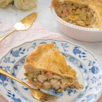 Pinterest graphic of a serving of turkey pot pie on a plate with gold colored serving utensils beside it.