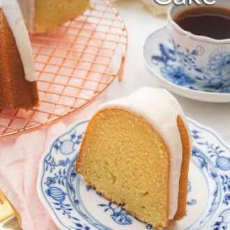 Pinterest graphic of a slice of Bundt cake on a blue and white plate beside a wire rack with the rest of the cake and a cup of coffee.