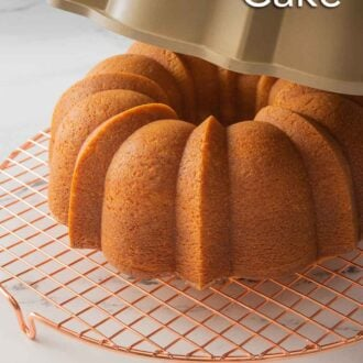 Pinterest graphic of a vanilla Bundt cake on a wire rack with the Bundt cake pan being removed.
