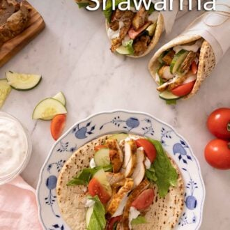 Pinterest graphic of three wrapped chicken shawarma with one on a plate, with the pita opened.