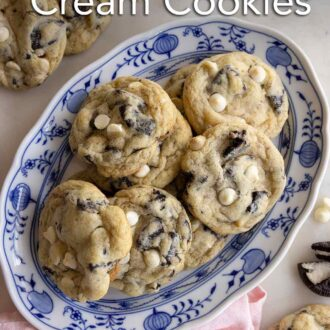 Pinterest graphic of an oval platter of cookies and cream cookies with a couple scattered around alongside Oreos.