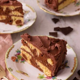 Pinterest graphic of three slices of marble cake with one in focus in the front beside a pink linen napkin.