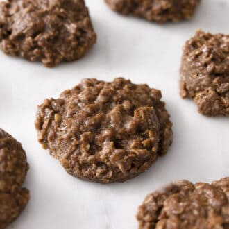Chocolate peanut butter no Bake Cookies on a marble surface.