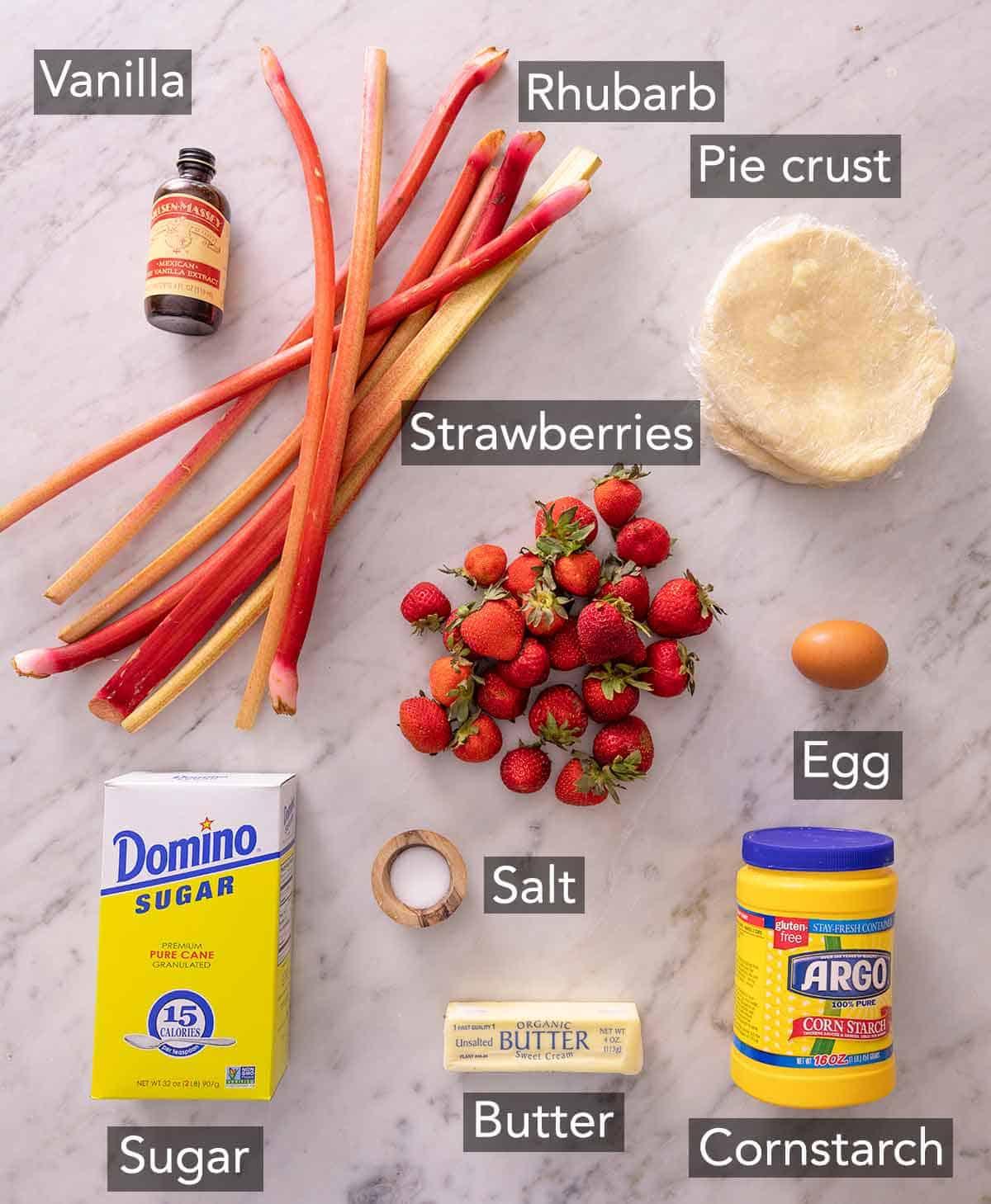 Ingredients needed to make strawberry rhubarb pie.